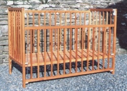 Drop side cot made from reclaimed Pitch Pine